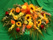 Sympathy Casket Spray Fall-color from Mischler's Florist and Greenhouses in Williamsville, NY